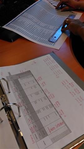 FTS validates and curates information. In this example, an FTS team member checks information provided in the common humanitarian fund (CHF) report from Somalia, November 2015.